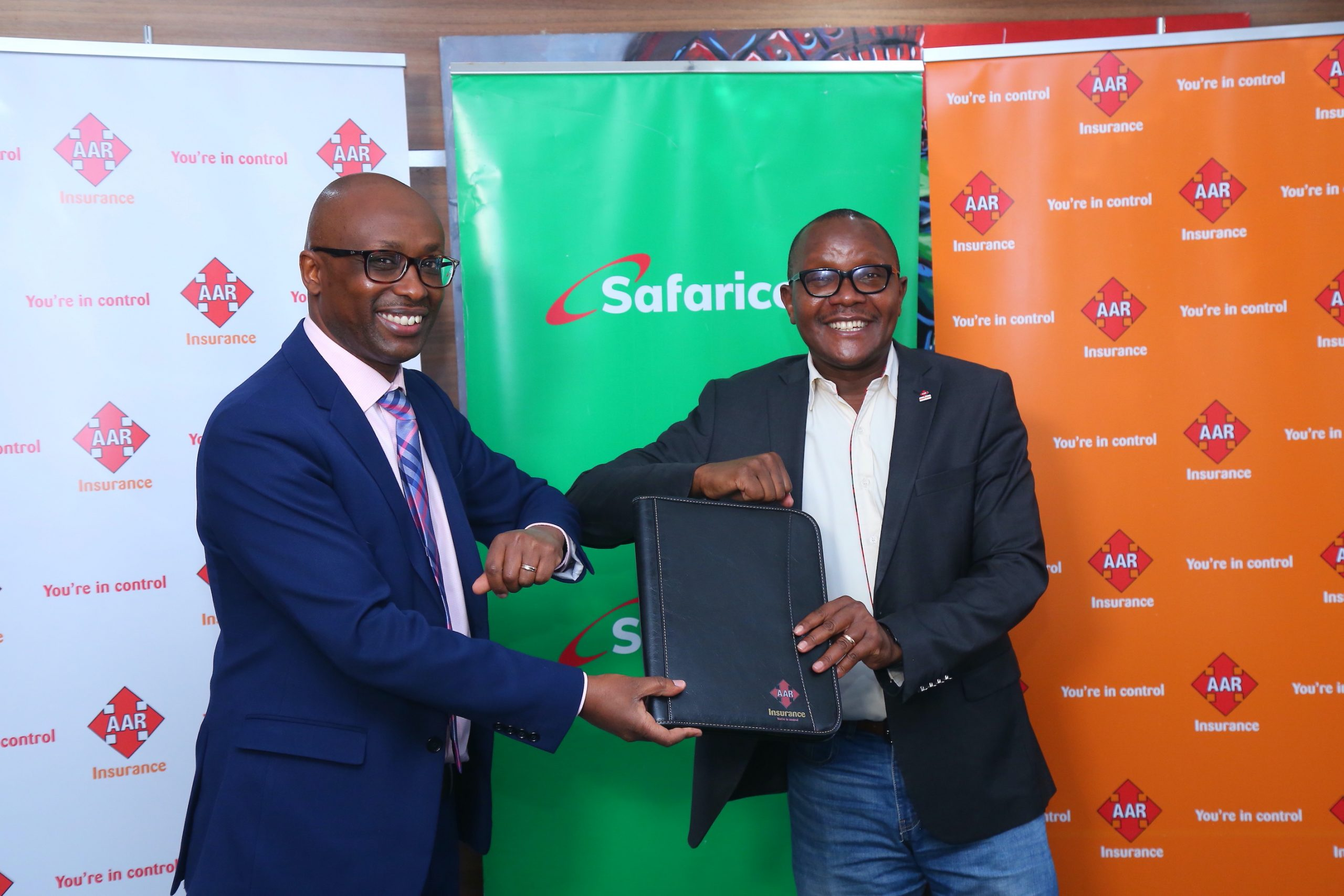 AAR Insurance Kenya Managing Director Nixon Shigoli (Right) and Safaricom Head of Department-Large Enterprise and Public Sector Joseph Wanjohi soon after signing a deal that will see the medical underwriter migrate its digital tools and core systems to the Amazon Web Services (AWS) platform, a move set to offer AAR Insurance Kenya clients more secure and efficient digital services.